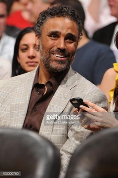 News Photo : Former NBA player Rick Fox attends a game between...