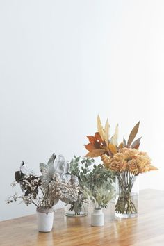 Tiny autumn bouquets   orange flowers + vintage greens