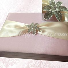Rose pink boxed wedding invitation with hinged lid and floral crystal brooch will transfer luxury to all wedding events.