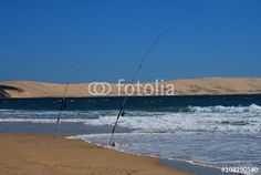 two fishing poles at the Atlantic coast with Europe's biggest wandering dune, the dune of Pyla, in the background. Fishing Poles, The Dunes, Coast, Europe, Big, Beach, Water, Outdoor, Pictures
