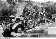 Elements of the SS-Totenkopf-Division near Demjansk, Eastern front, northern sector, September 1941.  Deutsches Bundesarchiv Bild 146-1977-093-07  Sowjetunion.- Motorisierte Einheit der Waffen-SS-Totenkopf-Division beim Vormarsch, Krupp-Protze (Sd. Kfz. 69) mit angehängter, leichter Panzerabwehrkanone (Pak) beim Durchfahren eines Gewässers / einer Furt; SS-PK