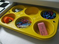 old/cheap muffin pan spray painted  and used to keep your desk organized