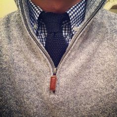 Layering for men 101. Grey cashmere men's sweater, blue gingham shirt and knit tie.