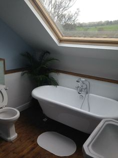 Justin from Leeds #VPShareYourStyle this free standing bath tub looks fabulous next to the attic window. What a view.