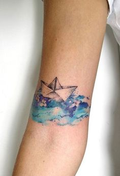 Lovely paper boat tattoo. Click on image for more exquisite watercolor tattoos.