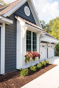 Lake House Exterior - Dark grey charcoal vinyl shake siding with white trim, pergola, window boxes and corbel details.