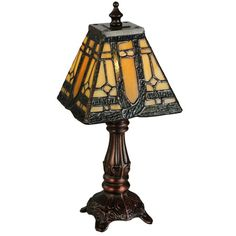 Art glass and a handsome bronze base combine to form this trend-setting Sierra Prairie Mission Mini Lamp. Designed with a Tiffany style shade, this light will brighten any room. Simple Geometric Designs, Tiffany Table Lamps, Crushed Glass, Transitional Wall Sconces, Room Lamp, Cool Floor Lamps, Stained Glass, Bulb, Lighting
