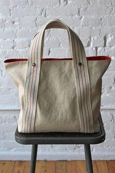 bolsa de mano con tira de loneta