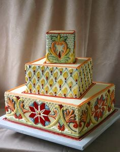 Gold buttercream with hand-piping inspired by Talavera pottery. Cakes to Remember Brookline, MA
