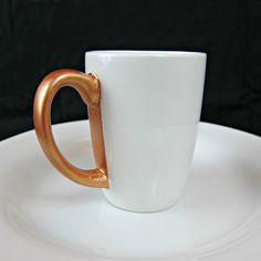 Painted Dollar Store Mug- maybe paint each one in a different metallic color?