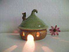 Fairy house! Run solar lights under moss between houses to make the fairy village light up around the pond!!