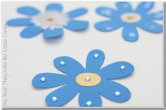 Cute idea for Considerate & Caring petal - each girl decorates 3 paper daisies.  They take them home and do considerate or caring acts for friends or family and leave them behind as a reminder that a considerate & caring Daisy was there.