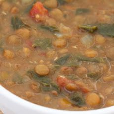 Vegetarian Lentil Soup with Spinach, Tomatoes, and Cumin Ingredients 1 tbsp  olive oil  11/2 tsps  cumin seeds (not ground)  1  onion  chopped small 4 cloves  garlic   ground coriander (1/2 tsp.)   black pepper   paprika (1 tsp.)  11/2 cups  brown lentils  4 cans  vegetable broth or water, about 7 cups,  chicken stock  141/2 ozs  juice  diced tomatoes 2 cups  spinach  salt