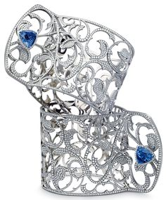 Francis Mertens titanium and diamond cuffs appointed with tanzanites.