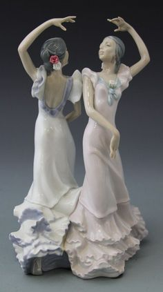 """Lladro porcelain figurine by sculptor Jose Luis Alcarez, issued in 1989. """"Ole"""" captures the Spanish tradition of Flamenco dancing, and features two dancing ladies. Measures 9 3/4 inches X 6.14 inches"""