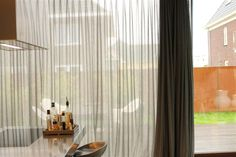 Sheer curtains in Dutch kitchen  by RoedesOnline.nl - Interieur.Me