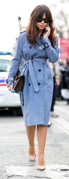 Paris Fashion Week street style: Mira Duma wearing a pale blue trench coat, nude pumps and carrying a Louis Vuitton bag