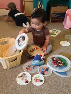 Photo language disks are easy to add to babies play! Collection of flexible lids. i.e.: butter, ice cream, sour cream, infant formula, frosting etc...Mod podge to adhere photos from magazines & catalogs, or even family photos. (Options for shapes, colors, animals) I used photos depicting our routine & activities as well as expand beyond our environment!
