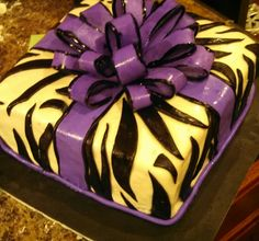 Purple zebra print bow cake.