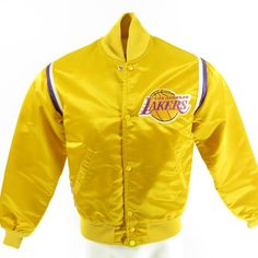 <p>There's only one way to show that you've been a fan of the Los Angeles Lakers longer than anyone else and the is with an authentic vintage 1980s Starter Jacket. It has all the official patches and trimmings you've been looking for. Now there will be no question who the real champion is!</p>