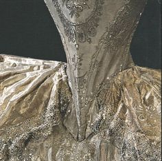 Detail of bodice, skirt & train arrangement on a robe de cour. As can be seen, the bodice is cut to below the waistline. The train is tied on, its fixing being concealed by the ornamental tabs at the base of the bodice. This is a detail of the beautiful gown which was worn by Gustav III's sister-in-law at her wedding in 1774.