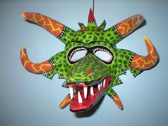 Green and Orange: This beautifully crafted, labor intensive Vejigante Carnival Mask from Ponce, Puerto Rico handcrafted and signed by the artist E. These are papier mache masks Face Symmetry, Puerto Rico, Puerto Rican Music, Puerto Rican Culture, Hispanic Culture, Costumes Around The World, Caribbean Carnival, Carnival Masks, Fantastic Art