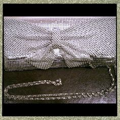 Silver Bowed Evening Bag in the Poshmark closet! My username is: thesilkcloset1. #shopmycloset #poshmark #fashion #shopping #style #forsale #Handbags