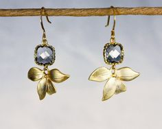 SALE Angles and dangles. gold flower earrings. Square framed and faceted charcoal grey quartz with orchid flower