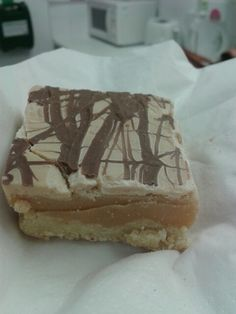 Millionaires shortbread. Topped with melted caramac and drizzled with galaxy chocolate.