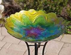 Colorful glass bird bath from Evergreen  http://www.myevergreenonline.com/p-94361-birdbath-nature-inspired.aspx