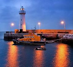 RNLI lifeboat, & lighthouse at the harbour.Donaghadee,County Down, Northern Ireland.My mother's natal town. Ireland Uk, Ireland Travel, Bangor Northern Ireland, Northern Irish, Search And Rescue, Emerald Isle, British Isles, Great Britain, Vacation Spots