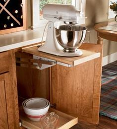 Love it. http://www.kraftmaid.com/products/storage-solutions/kitchen/cooking/base-mixer-shelf.html#/p:1