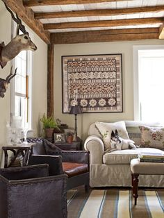 The furnishing and accents in this living room include forties French leather armchairs, a framed batik print from Bali, and a flat-weave Peruvian room. #livingroom