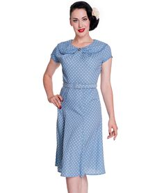 Tigermilly. may be too 40s looking.  Beautiful 40s vintage style tea dress with pretty small polka dot fabric detail.  Pretty peter pan style collar finished with matching braid and decorative button.  Flattering short sleeves edged with matching braid.    Fitted bodice with flared, panelled, lower skirt section.  Matching thin, adjustable belt.  Invisible zip to centre back.  Dress is unlined.  Machine washable    Material: 100% Polyester   Length : Knee Length