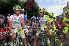 Stage 11 - Liquigas-Cannondale teammates Damiano Caruso and Ivan Basso chat on the start line.