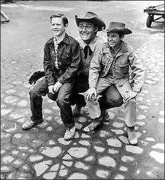 """On the set of """"The Rifleman"""" with Chuck & his boys along with his TV son Johnny Crawford (Mark McCain)"""