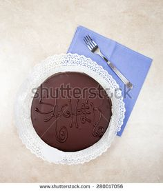 Sacher cake with vintage silverware - stock photo