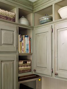 Open shelves hold cookbooks, display pieces, and baskets for supplies. And check out the crown molding and decorative molding that bookend the top tier of open shelves. Nice touch.