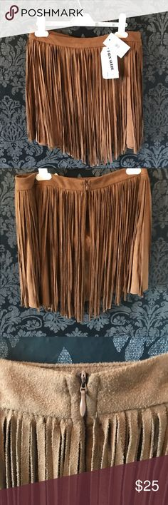NWT Brown Faux Suede Tassel Mini Skirt 70s flower child hippie western brown, camel colored fake leather skirt with tassels all around it. The tassel lengths vary to give it a V shape. Back has tassels too, and a zipper. New with tags and never before worn. I bundle at 20% off and ship next day, let me know if you are interested. From Nordstrom's. Great for biker chic, desert festivals, concerts, hipster, grunge, boho, indie, like free people, and anthropology, country, metal, 4, 6, summer…