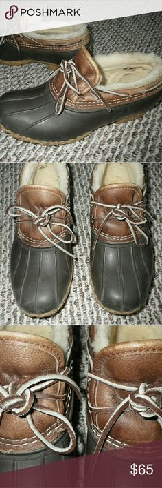 LL Bean Shearling Lined Moc Shoes / Low Duck Boots Good condition.  Shearling intact.  Soles show almost no wear.  Flaws:  small tear on back right label and shearling has some dried glue around side and back from manufacturer (LL Bean)...not felt or noticable when wearing (bare or sock footed).  Women's 7 Medium.  Brown leather, brown rubber, and cream shearling, L.L. Bean Shoes