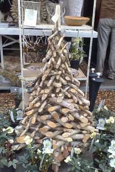 Christmas tree made of chopped logs Cork Christmas Trees, Noel Christmas, Rustic Christmas, Xmas Tree, All Things Christmas, Winter Christmas, Christmas Wreaths, Christmas Ornaments, Natural Christmas