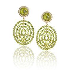 Misahara's Plima earrings feature an abundance of peridots, capturing the boho-style of the Californian jewellery brand. Discover more from the birthstone of August: http://www.thejewelleryeditor.com/jewellery/peridot-the-fascinating-story-behind-augusts-birthstone/ #jewelry #fashion
