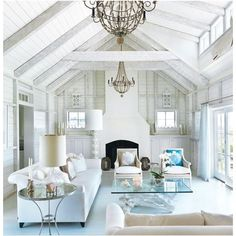 These high vaulted ceilings are perfectly accessorized with Arteriors Louis Iron and Wood Chandelier.
