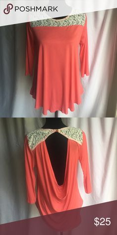 "3/4 Sleeve Scoop Back Blouse This super cute 3/4 sleeve scoop back blouse is so soft! Could be worn with a cute lace bralette or tank. 22"" across under arms and 23"" long. 95% Polyester 5% Spandex. Top is new retail but does not have tags. Tops Blouses"