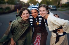 My sisters and friend in their homemade Leia, Ashoka Tano, and Aunt Beru Costumes for Star Wars Day, AKA May the 4th Be With You