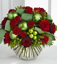 FTD Holiday Bliss Bouquet - PREMIUM  Price: 94.90    The FTD Holiday Blissand#153; Bouquet brings the joy and good tidings of the holiday season straight to their door. Bursting with bright seasonal color, this bouquet boasts both red roses and spray roses whimsically accented with green hypericum berries,
