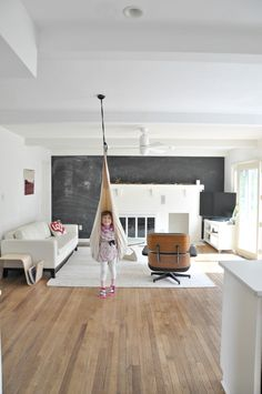 Black and White living room with an indoor kid's swing. | on DESIGN + LIFE + KIDS