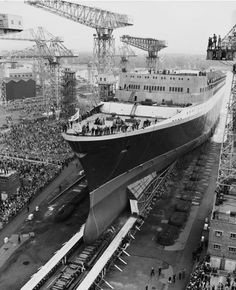 The Cunard ocean liner 'RMS Queen Elizabeth enters the water at Clydebank in Scotland September 1967 She was christened and launched by Queen. Rms Queen Elizabeth, Qe 2, Titanic Photos, Glasgow Scotland, Ways To Travel, British Style, Journey, Ocean, City