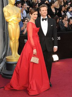 Colin Firth, last year's Oscar winner for best actor for The King's Speech, walks the carpet with his wife, Livia Giuggioli.