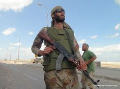 Matthew VanDyke with his AK-47 during a mission with the Ali Hassan al-Jaber brigade in Sirte during the Libya War